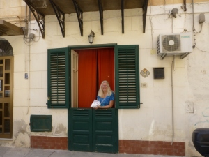 Helen, our apartment stable doors and the 3 kilos of Trapani salt we bought for 1 Euro